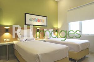 Dekorasi simpel kamar tipe Superior Twin Bed Griya Karangsuci Homestay